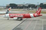 やまっちさんが、シンガポール・チャンギ国際空港で撮影したタイ・エアアジア A320-216の航空フォト(写真)