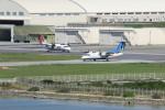 オポッサムさんが、那覇空港で撮影した琉球エアーコミューター DHC-8-103 Dash 8の航空フォト(写真)