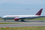 よっしぃさんが、中部国際空港で撮影したオムニエアインターナショナル 777-2U8/ERの航空フォト(写真)