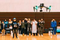 ニュース画像 1枚目:ドローンPROパイロット技能認定会での見本飛行