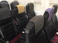 ニュース画像:JAL、9月から鹿児島県品をPR 客室乗務員は大島紬エプロンを着用
