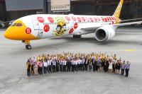 ニュース画像:スクート、関空初の定期便はシンガポール建国50周年の特別塗装機