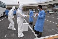 ニュース画像 1枚目:輸送後の消毒の様子