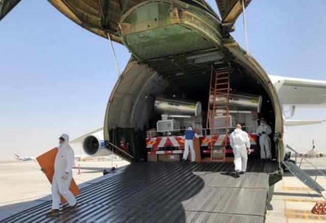 ニュース画像 1枚目:アントノフ An-124で輸送される路上消毒車