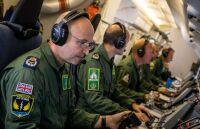 ニュース画像 2枚目:機内での監視活動