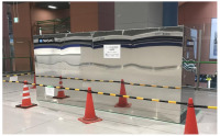 ニュース画像:関空、手荷物カートUVC除菌で実証実験 専用装置で一度に10台処理