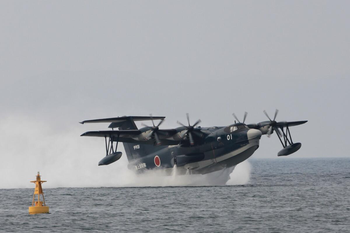 ニュース画像 5枚目:長崎空港と大村飛行場の間の海に設けられたシーレーンから離水するUS-2 (モモさん撮影)