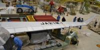 ニュース画像 4枚目:工場に搬入され、初めてその機体記号(レジ)「JA21MJ」を表した
