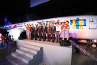 ニュース画像:マンダリン航空、737-800に特別塗装「花現台中」 12月3日から就航