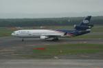 北の熊さんが、新千歳空港で撮影したワールド・エアウェイズ MD-11の航空フォト(飛行機 写真・画像)