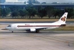 amagoさんが、ドンムアン空港で撮影したタイ国際航空 737-4D7の航空フォト(飛行機 写真・画像)
