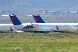 KAZKAZさんが、キングマン空港で撮影したコムエアー CRJ-100の航空フォト(飛行機 写真・画像)