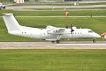 kon chanさんが、嘉手納飛行場で撮影したアメリカ企業所有 DHC-8-315B Dash 8の航空フォト(飛行機 写真・画像)