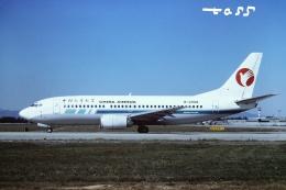 tassさんが、北京首都国際空港で撮影した中国新華航空 737-341の航空フォト(飛行機 写真・画像)