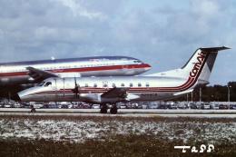 tassさんが、フォートローダーデール・ハリウッド国際空港で撮影したコムエアー EMB-120 Brasiliaの航空フォト(飛行機 写真・画像)