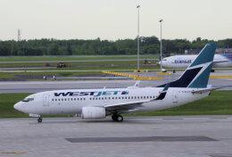 狛犬さんが、モントリオール・ピエール・エリオット・トルドー国際空港で撮影したウェストジェット 737-7CTの航空フォト(飛行機 写真・画像)