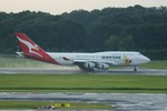 しんさんが、シンガポール・チャンギ国際空港で撮影したカンタス航空 747-438の航空フォト(飛行機 写真・画像)